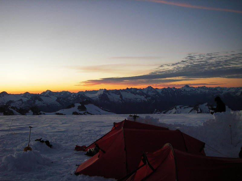 The Dragontain high camp on the Upper Tellot Glacier at sunrise.  Photo by Tom Gray.