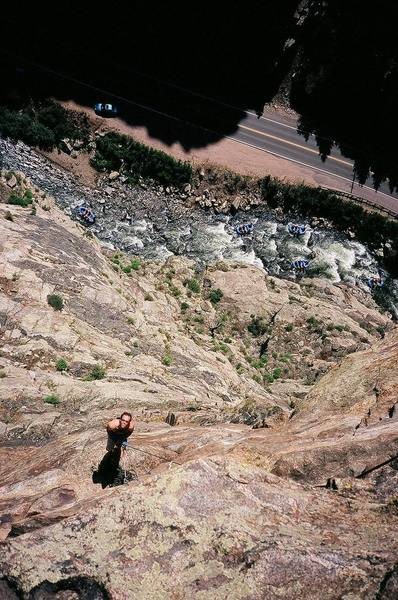 The exposed view looking down from mid-way up P5 of Solid Gold (5.12a) on Creek Side Crag in Clear Creek Canyon, Colorado.<br> Pictured: Josh Janes and many unknown rafters. Circa 7/'06.