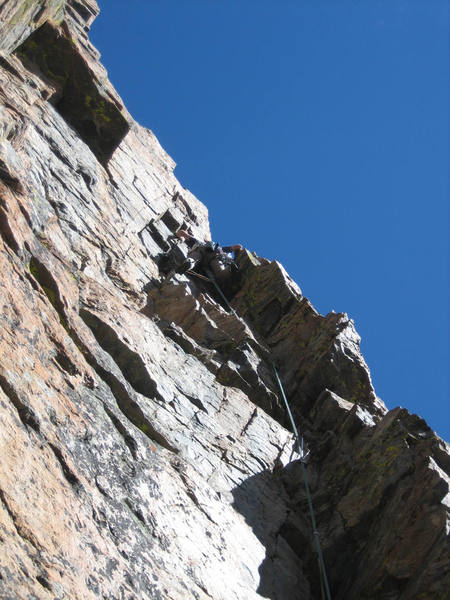 Mike Amato reaching the top of the fading dihedral on pitch 1.