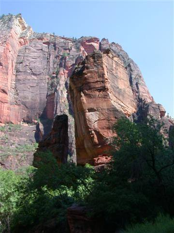 View of the pulpit from the parking lot. The route ascends the face hidden by the tree to the right, goes up the slanting ramp, and then the crack on the right of the arete.
