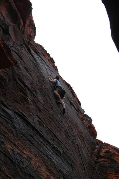 Dalon nearing the final crux move; very thin feet and lovin' that sloper edge!