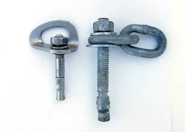 """To give you a sense how BIG this bolt is, here's the aforementioned failed 1/2"""" wedge bolt alongside a traditional 3/8"""" wedge bolt."""