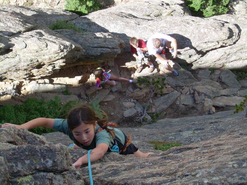 Kira, 10, face climbing the crack.