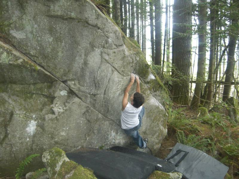 Sit down start on opposite side pulls to far right.  Traverse up and to the left on slopers