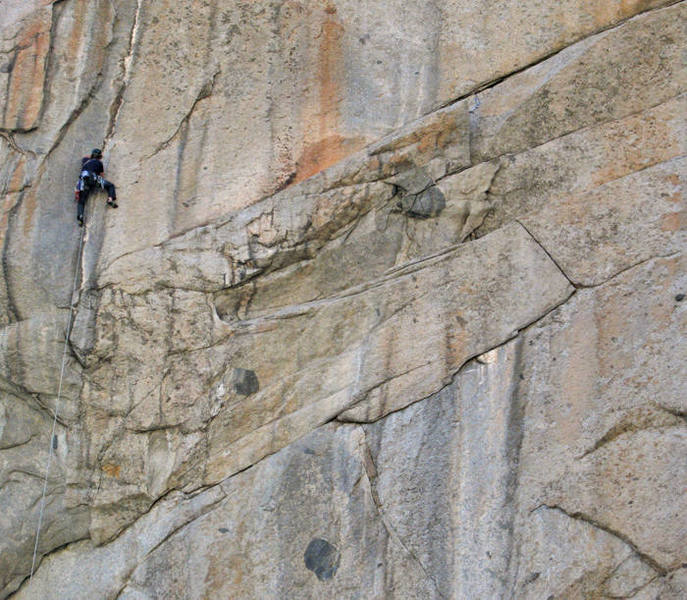 Traversing across the upper slab on Beastie Boys.  The rope was tampered with in photoshop.  Brendan Nicholson photo.