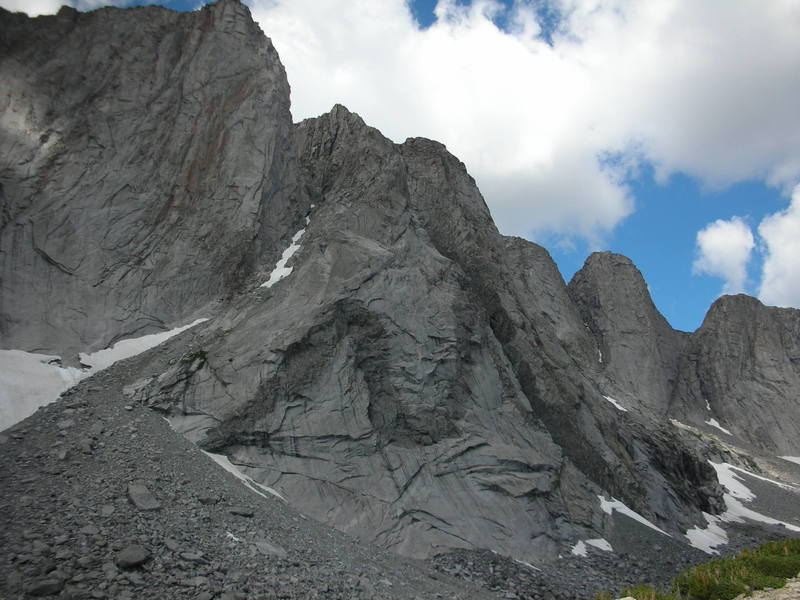 The Unmistakable M at the bottom of the Buttress. The route starts at the bottom left hand corner of the M's dike and follows to the obvious dihedral and then continues up the arete