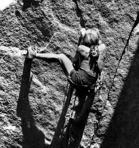 "Rick Cashner at the crux, on the first free ascent of ""Space Walk"" 5.11c. 1979.<br> Photo by Blitzo."