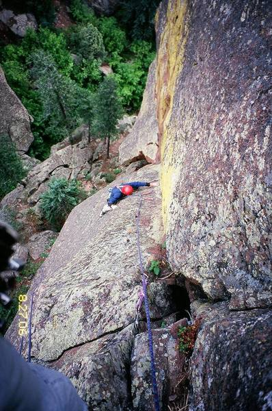 Ross cleans the gear before the final crux (5.10b) of Third Eye on the Achean Pronouncement of Skunk Canyon, in the Flatirons. Photo by T. Bubb, 8/06.