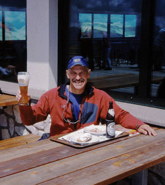 Enjoying lunch at the summit restaurant on Sass Pordoi, after a 12-pitch climb.<br> <br> Photo by Bruce Hildenbrand.