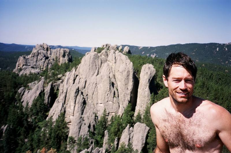 Tony Bubb atop Bell Tower in the Needles of S. Dakota. Photo by Jason Haas, 8/06.