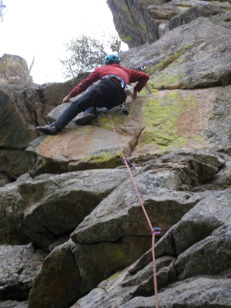 Ron Olsen stepping up to a great horizontal edge at the start of the arete.<br> <br> Photo by Bruce Hildenbrand.
