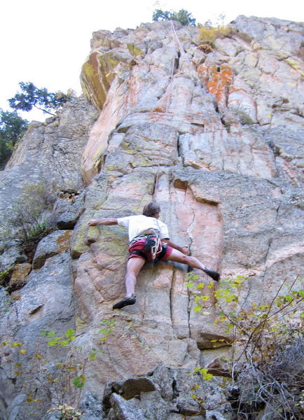Peter Dillon at the crux of the 5.10 start.