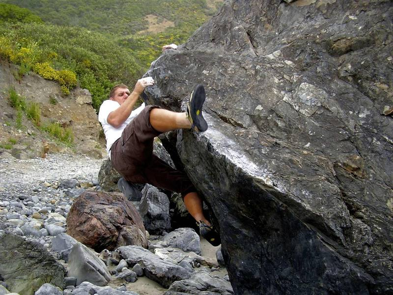 Unknown boulder, but has some nice routes ranging from v1 thru v5. A crash pad is needed in areas and a spotter is desirable as a spill even from 6' feet high will result in a nasty injury on the south side of the boulder.