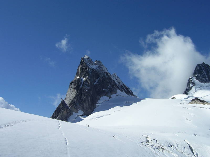 View of Pigeon Spire from the northeast. The West Ridge route follows the right skyline of the spire.