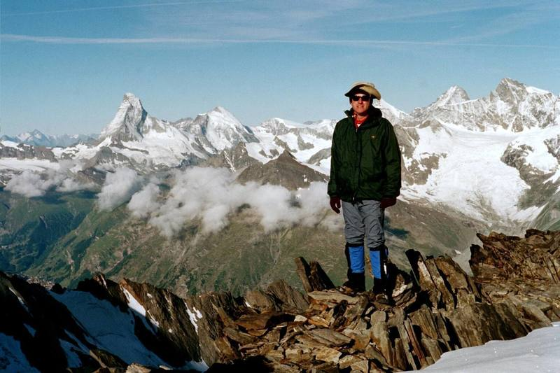 On the ridgeline of the Festigrat on the Dom in Switzerland on 5 Jul 03.  Matterhorn on the skyline to the left.