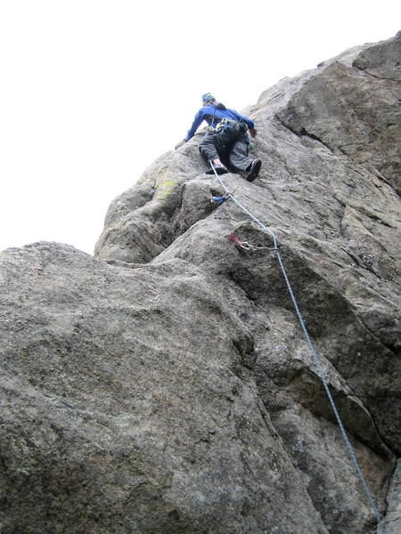 """Mike Borkowski getting ready to move left onto the arete.  There's a blind placement for a .5""""-.75"""" cam near his left hand."""