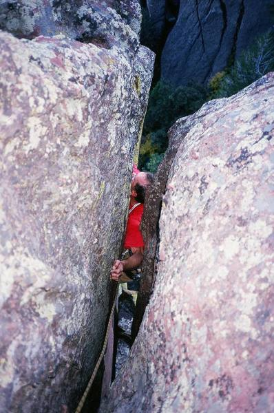 """Chris Parks Uses technique #1 (arm bar with cling) in the overhanging crack on """"Euclid's Corner"""" (5.10c, PG-13) on Ridge 3 of Skunk Canyon in the Flatirons. Photo by Tony Bubb, 9/06."""