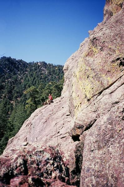 Chris Parks tries to get a ride up the Mohling Arete (5.5) on the back of this giant turtle wearing a beret. Photo by Tony Bubb, 9/06.