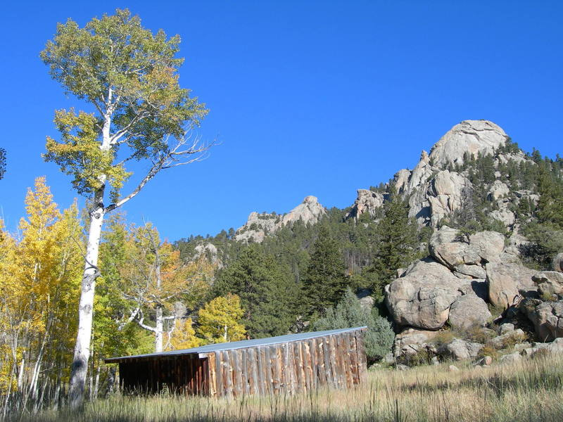 Looking up at Batman Rock & Batman Pinnacle from the cattle shelter along the Lumpy Ridge trail.