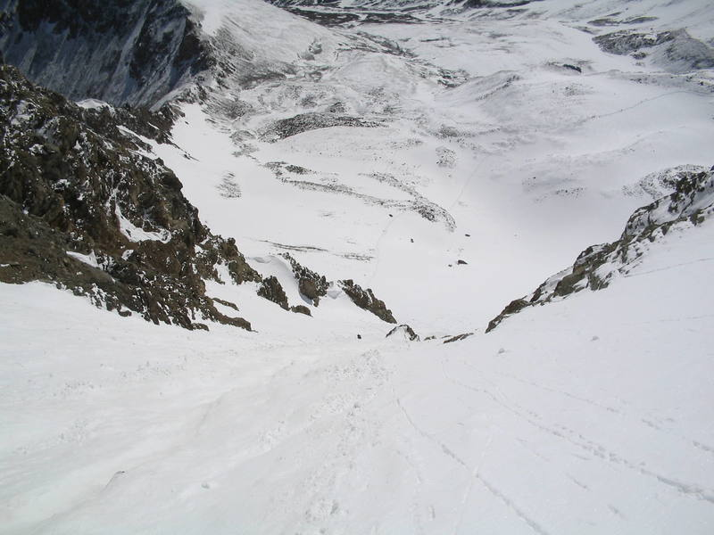 Anne Cassady (the little black dot) and the rock she was spit out on to her right, after being swept down the couloir by a point release avalanche. Ben Williams was swept over the rock and carried almost twice as far.
