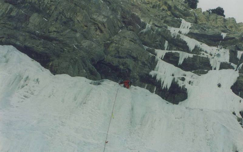Climbers on the upper pitchs.  It's been a few years so I don't remember what ones, but it's about half way up.  01/1992 Photo by Shawn Kenney.