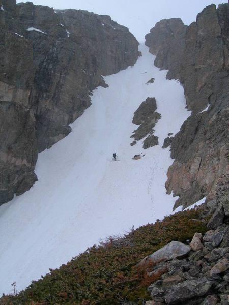 A skier descends Chaos Couloir.