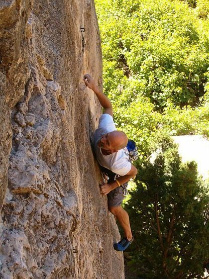 Bill locking off on Jackson Five Ten (5.10a), Jacks Canyon