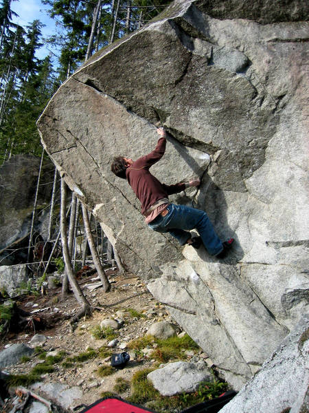V5 on the Equinox boulder. Getting ready for the crux.