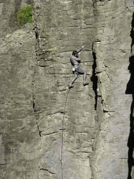 """Aaron on """"Bush in a Blender"""" finishing the crux sequence."""