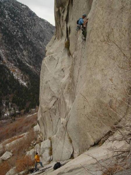 Shaun G climbing with Adam belaying on Riveting.