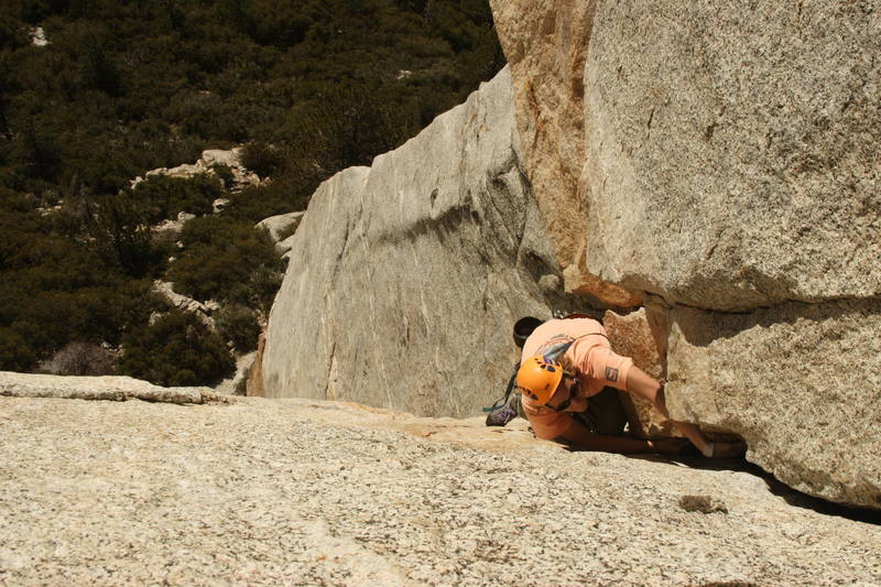 Charlie, rounding the roof and arriving at the second Belay stance of Open Book<br>