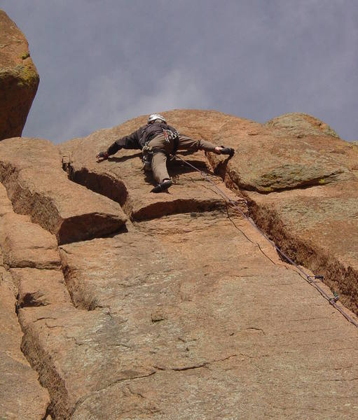 The direct finish. Gear was better than expected. Once stood up on the hump to my right, I used the arete on the right to make the final face moves. Plan B is to move left into a crack between this and Honky Jam Ass Crack.<br> <br> Photo by Paul Rezucha.