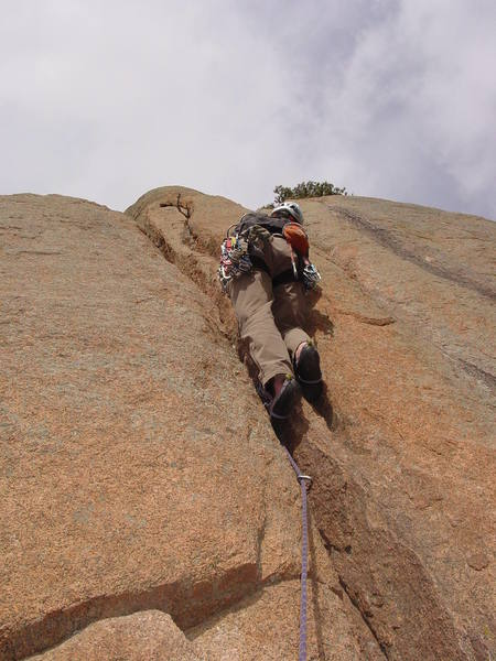 A crack on the right helps you get past a narrowing of the main crack.<br> <br> Photo by Paul Rezucha.