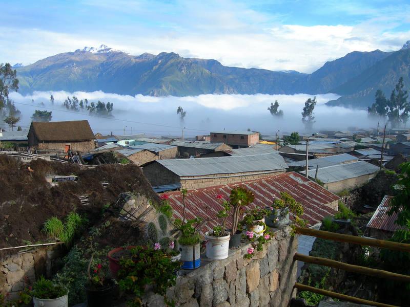 Fog blankets Canon del Colca at sunrise, southern Peru.