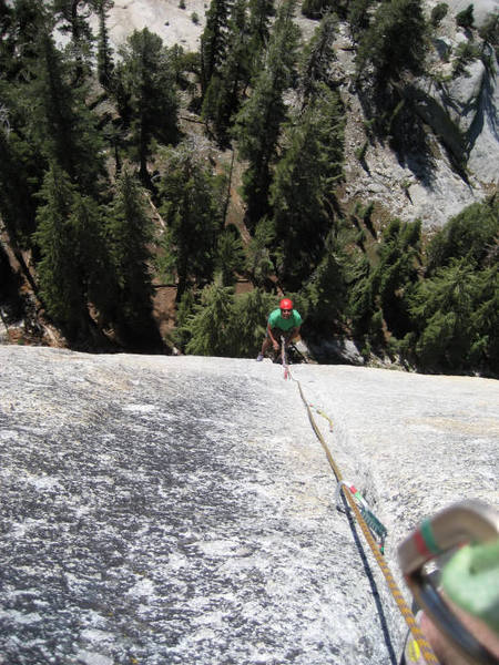 Ryan G. at 2nd belay of West Crack, Daff Dome, Tuolumne Meadows, 2006. Photo by Avery Nelson