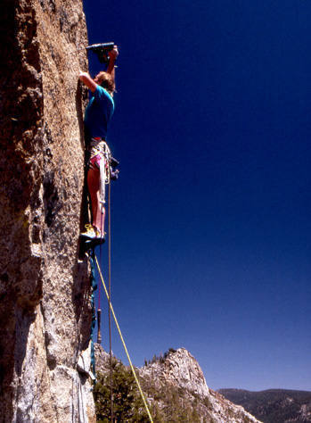 """Al Swanson drilling on the first ascent of """"Golden Shower"""".<br> Photo by Blitzo."""