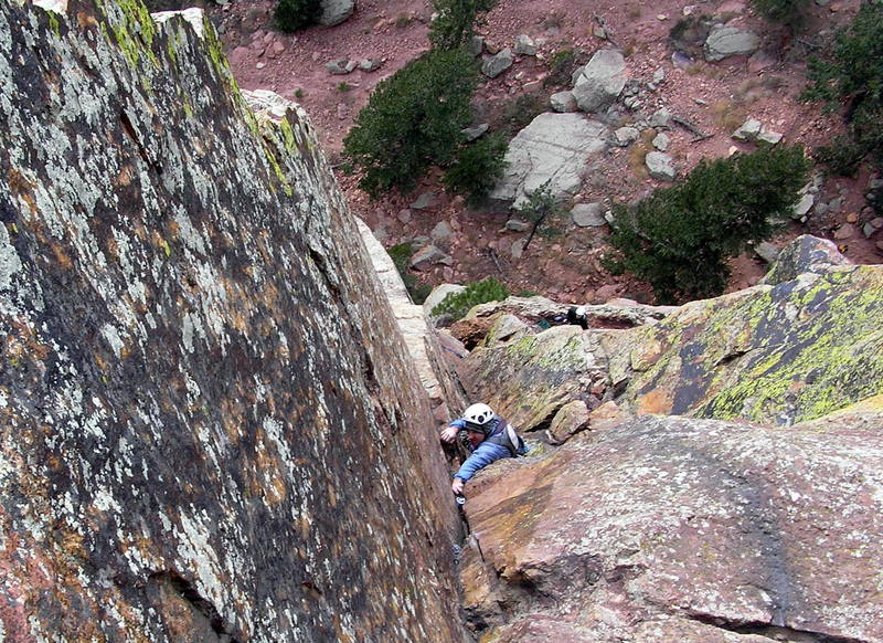 Mike Morley exiting the P4 traverse onto easier ground. Photo by John Fernandez.