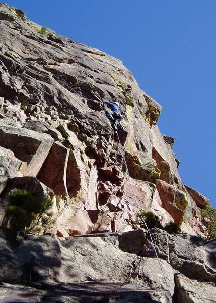 Making the moves up to the base of the crux groove.