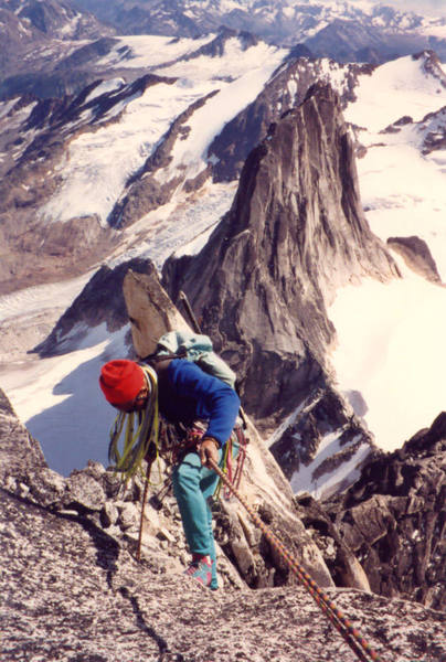 Tony Tennessee rappels towards the Gendarme on the Kain Route during the descent. Snowpatch Spire behind.