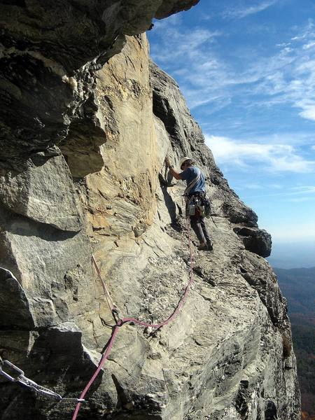 """Having made the famous """"move"""" on P2 of Peek-a-Boo, I now look for placements to protect my second on the traverse.  Photo by Huong."""
