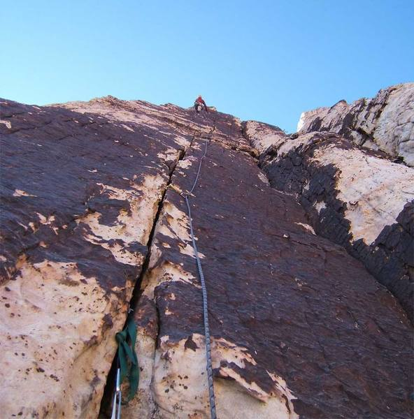 The clean crack on pitch 3 of the upper facet has magnificent climbing.