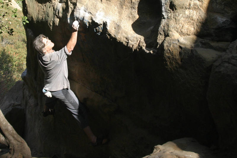Chris Owen approaches the crux - photo by Stefan Harms