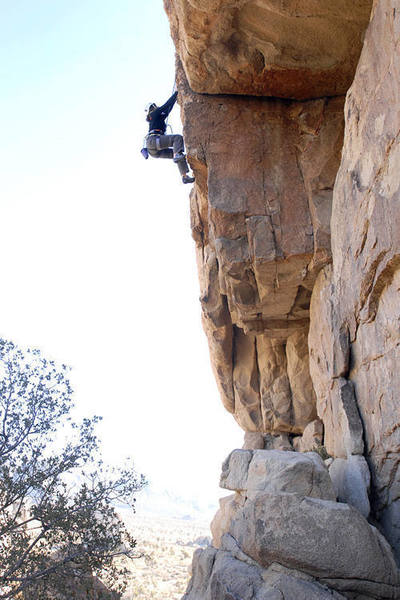 """Kathy Boussina climbs an overhanging crack and face after exiting the namesake on """"Super Roof."""""""
