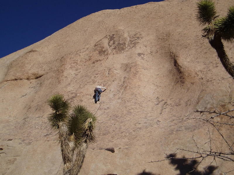 Kris moving through the crux on a cool windy day.