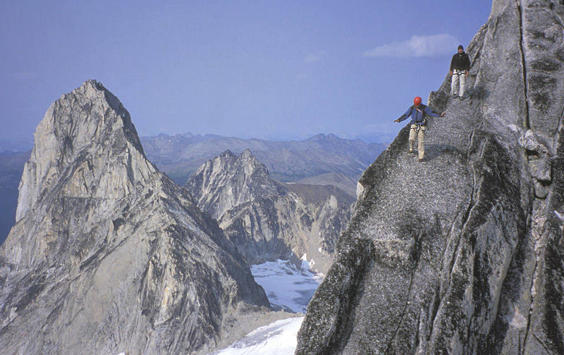 Lisa Foster and Paul Kejla on the descent with Bugaboo Spire on the left.