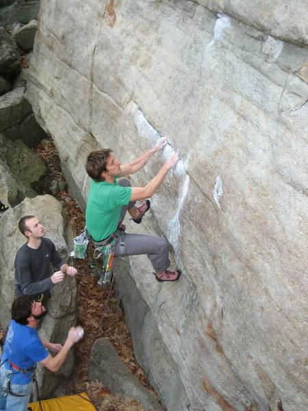 Getting set up for the boulder problem on The Sting, which is a big lunge to the next horizontal. Photo Kayte Knower.