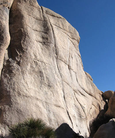 """Hot Rocks"" climbs the beautiful crack, photo center.<br> Photo by Blitzo."