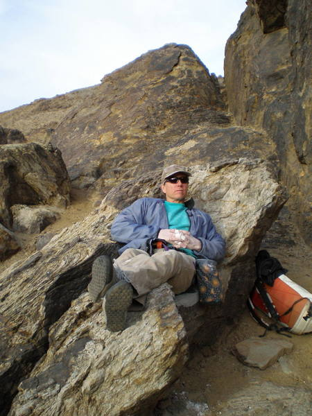 Relaxing at the base of Hueco Wall.  Nice seat!