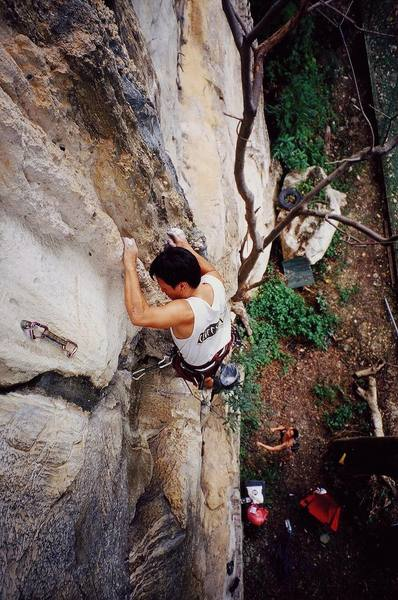 Kenny Low in a gaston on a 6b at Nanyang Wall, in the Batu Caves area of K.L., Malaysia. Photo by Tony Bubb, 12/06.