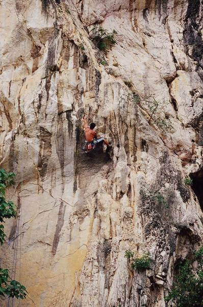Steve at the crux of a 6b+ at Nanyang Wall, in the Batu Caves area of K.L., Malaysia. Photo by Tony Bubb, 12/06.